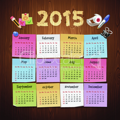 Office Stickers Calendar 2015 calendar on Wooden Background