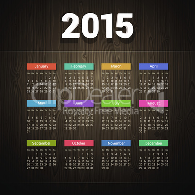 Simple 2015 calendar on Dark Wooden Background