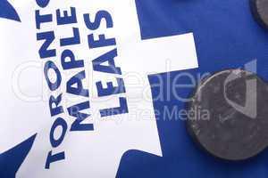 KHARKOV UKRAINE JANUARY 22: Toronto Maple Leafs jersey and old hockey puck