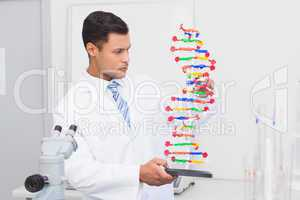 Focus scientist looking at DNA helix