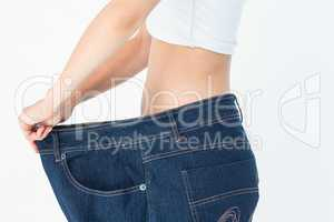 Woman belly in too big pants