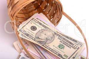european money on wooden basket, hryvnia, dollars, euro