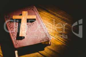 Crucifix icon resting on the bible