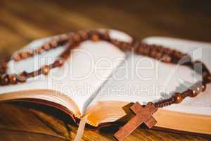Open bible with rosary beads