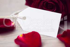Rose petals and white card