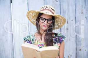Smiling beautiful brunette reading a book