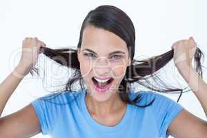 Furious woman pulling her hair