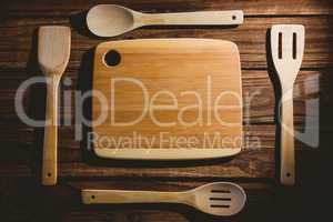 Chopping board with wooden utensils