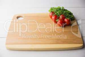 Chopping board tomatoes and parsley
