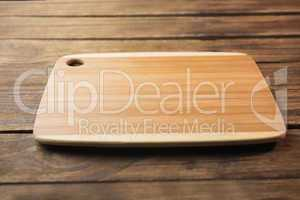 Chopping board on wooden table