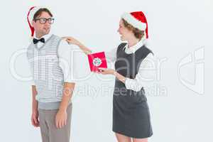 Geeky hipster offering present to her boyfriend