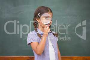 Pupil looking camera with magnifying glass