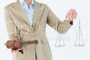 Young woman holding scales of justice and a gavel