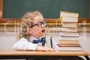 Surprise pupil looking at books
