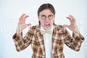 Furious geeky hipster looking at camera