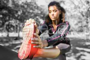 Highlighted ankle of stretching woman