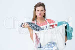 Hipster woman holding laundry basket