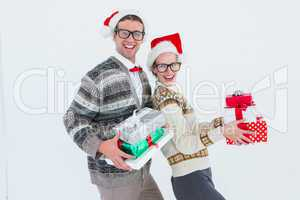 Geeky hipster couple holding presents