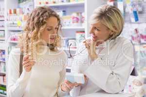Pharmacist explaining medicine to his customer