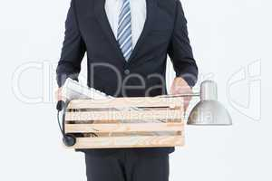 Businessman holding box of his things