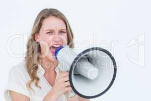 Woman shouting through a loudspeaker