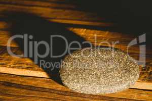Pebble on a wooden table