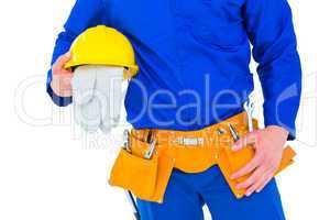 Handyman holding helmet