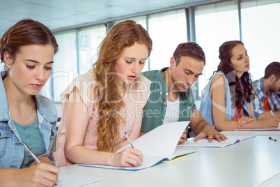 Fashion students taking notes in class
