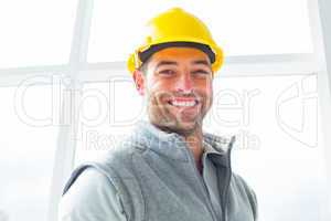 Manual worker wearing hardhat in building
