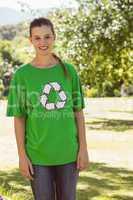 Environmental activist smiling at camera in the park