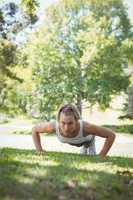 Fit woman in plank position