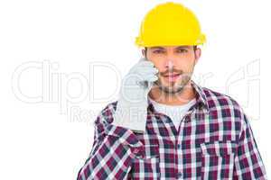 Repairman talking on mobile phone