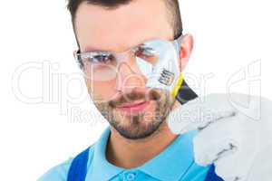 Repairman looking through adjustable wrench