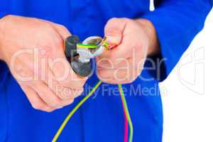 Electrician cutting wire with pliers
