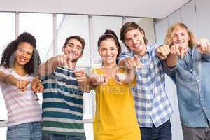 College students pointing at camera