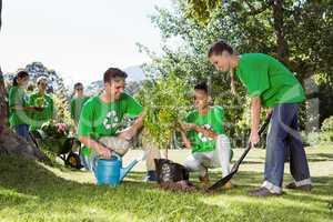 Environmental activists planting a tree in the park