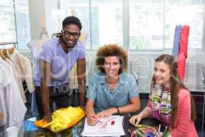 Team of fashion designers sketching