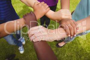 Children holding hands together at park