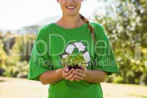 Environmental activist showing a plant