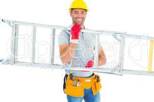 Smiling male workman carrying ladder