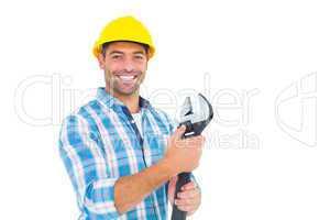 Portrait of smiling handyman holding adjustable spanner