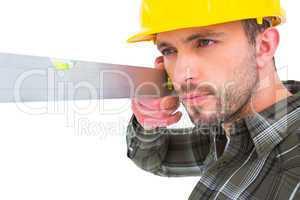 Carpenter using spirit level