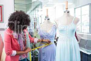 Designer measuring dummys waist