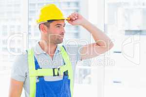 Manual worker wearing yellow hard hat