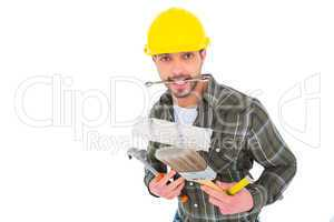 Manual worker holding various tools