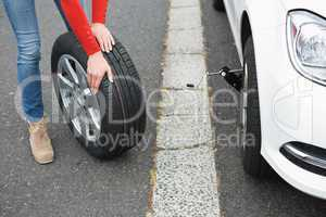 Woman replacing tire