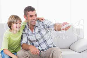 Happy father and son using remote control