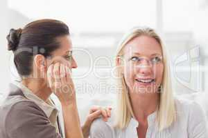 Women gossiping at home
