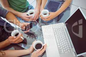 Fashion students holding cup of coffee