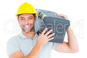 Confident handyman carrying toolbox on shoulder